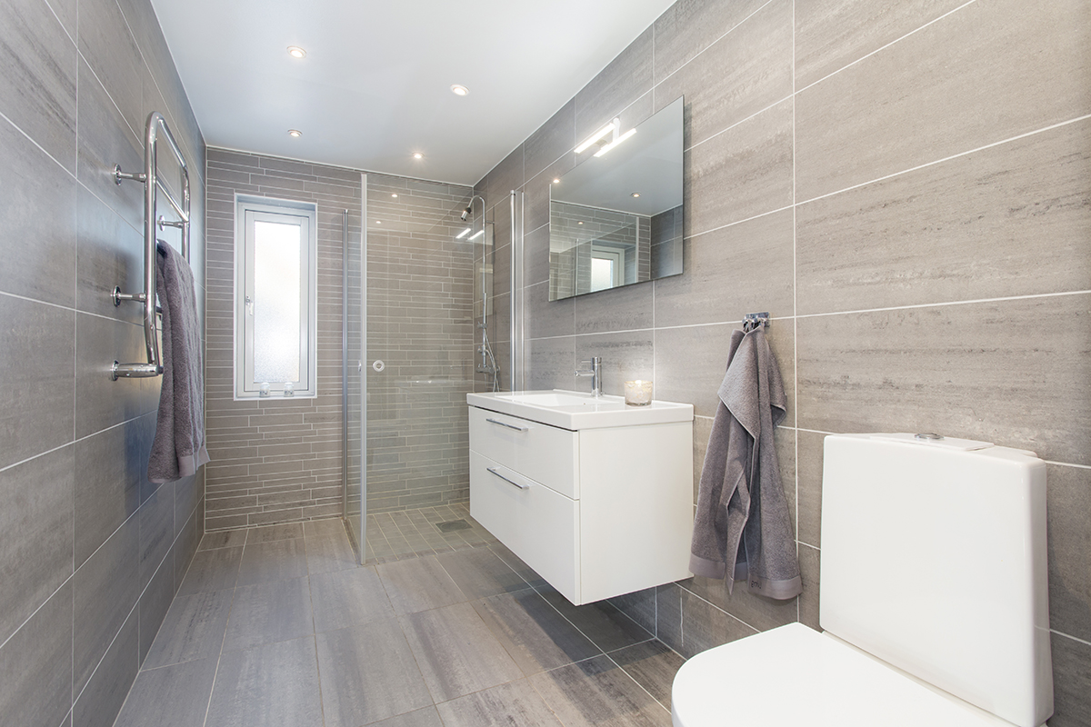 Modern bathroom renovation with walk in shower full height tiles and wall hung vanity