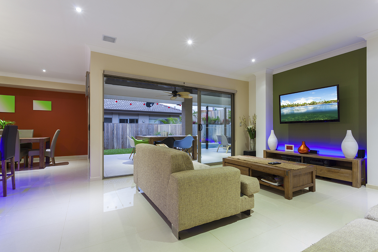 Open plan interior with colourful furniture and LED lights