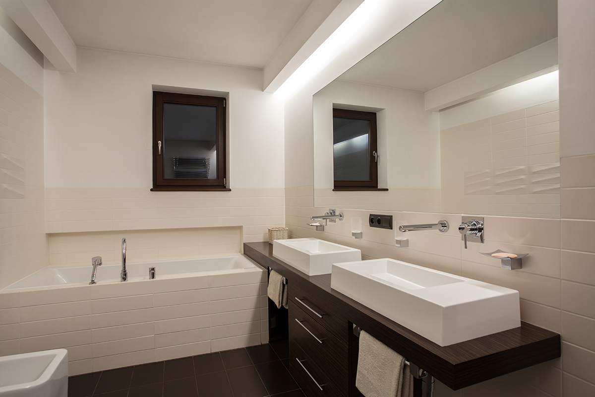 Bathroom renovation with double basin bath and subway tiles