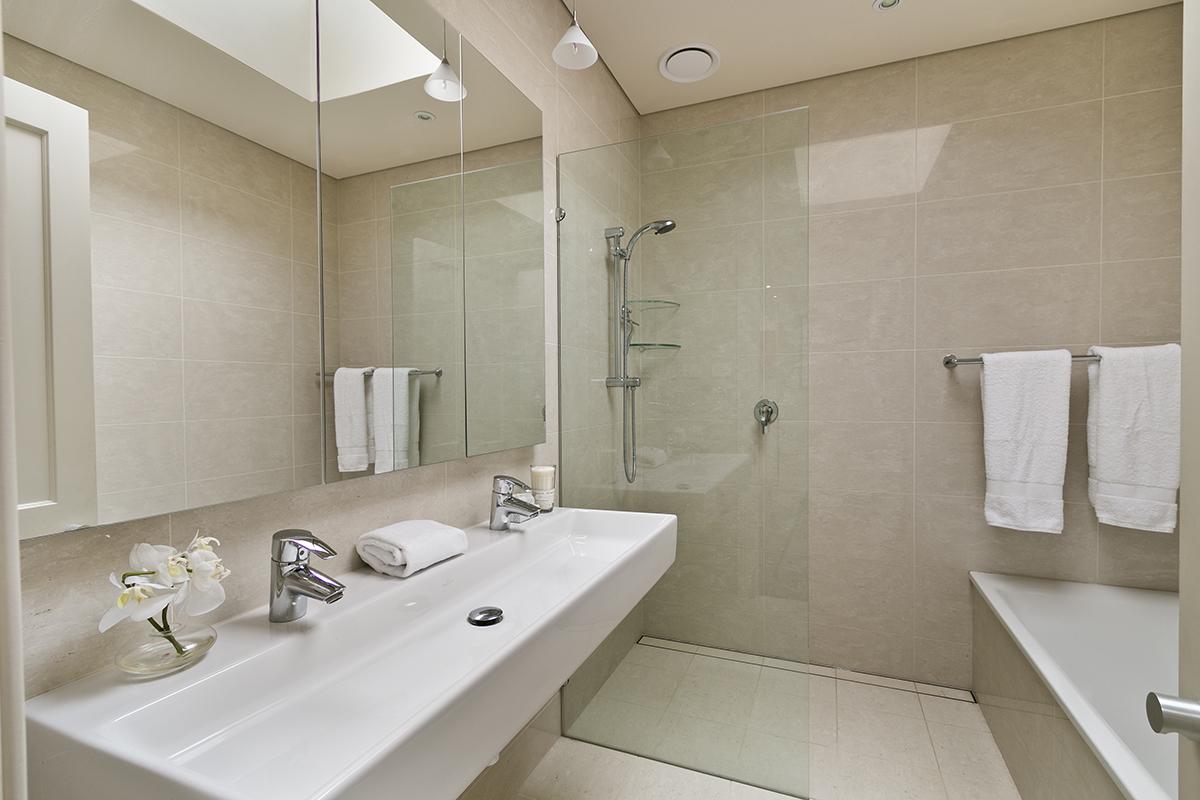 Bathroom renovation wall hung vanity walk in shower medicine cabinet